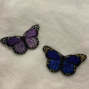two butterfly iron on patches